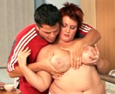 Plump redhead titfucked and plowed in kitchen