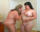 Two plump women in lesbian action