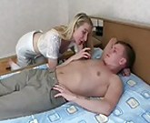 Russian Mom fucks with a young boy in the bedroom